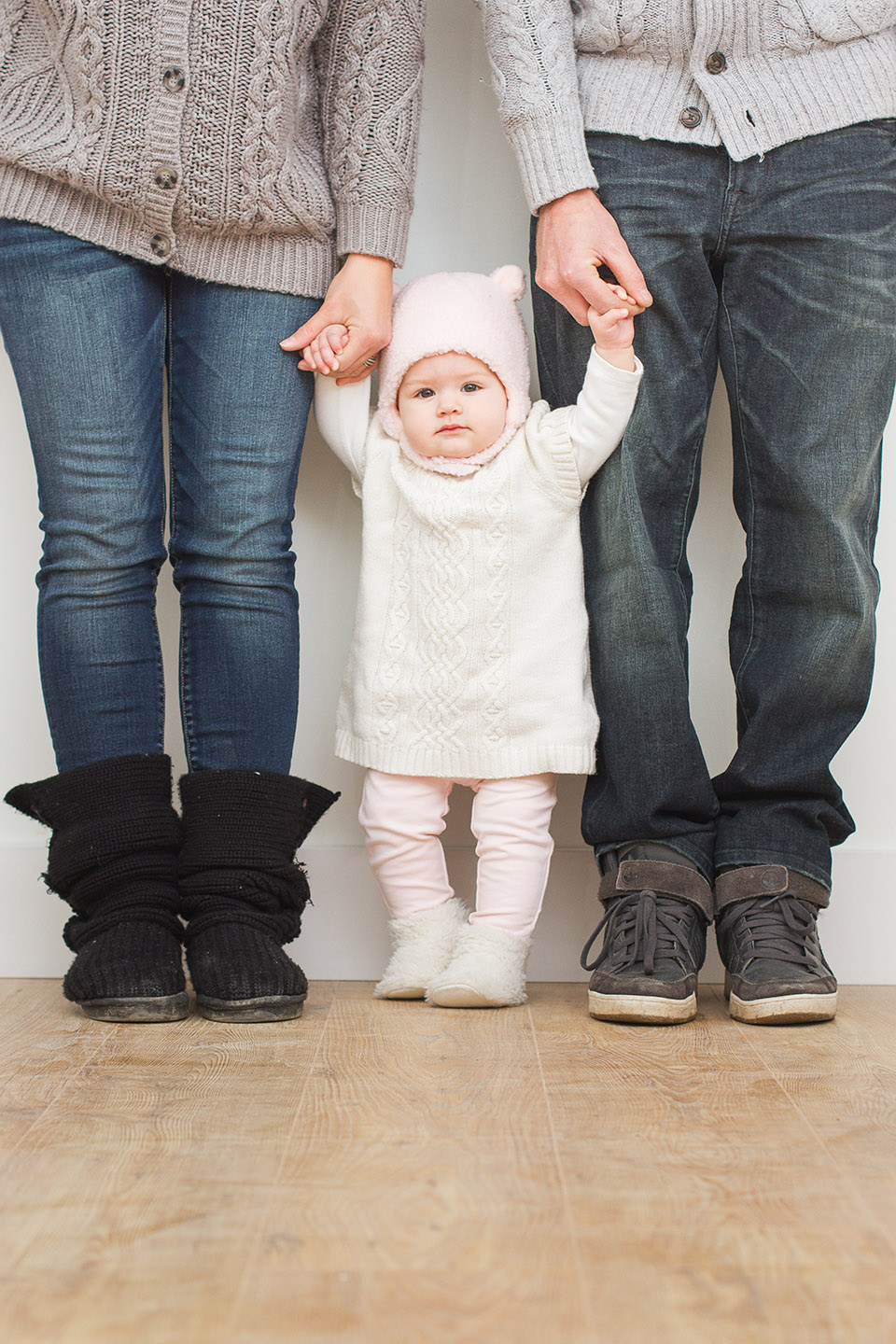 A portrait of a child with her family taken by Frank Myrland Photography