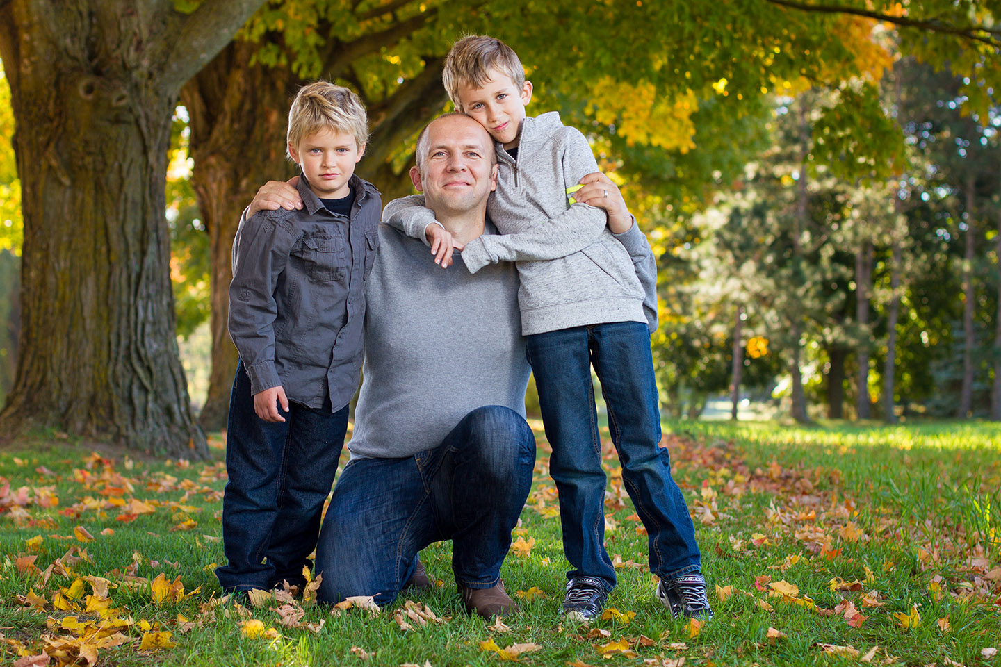 Portrait of a father and his boys in Hockley, taken by Frank Myrland Photography