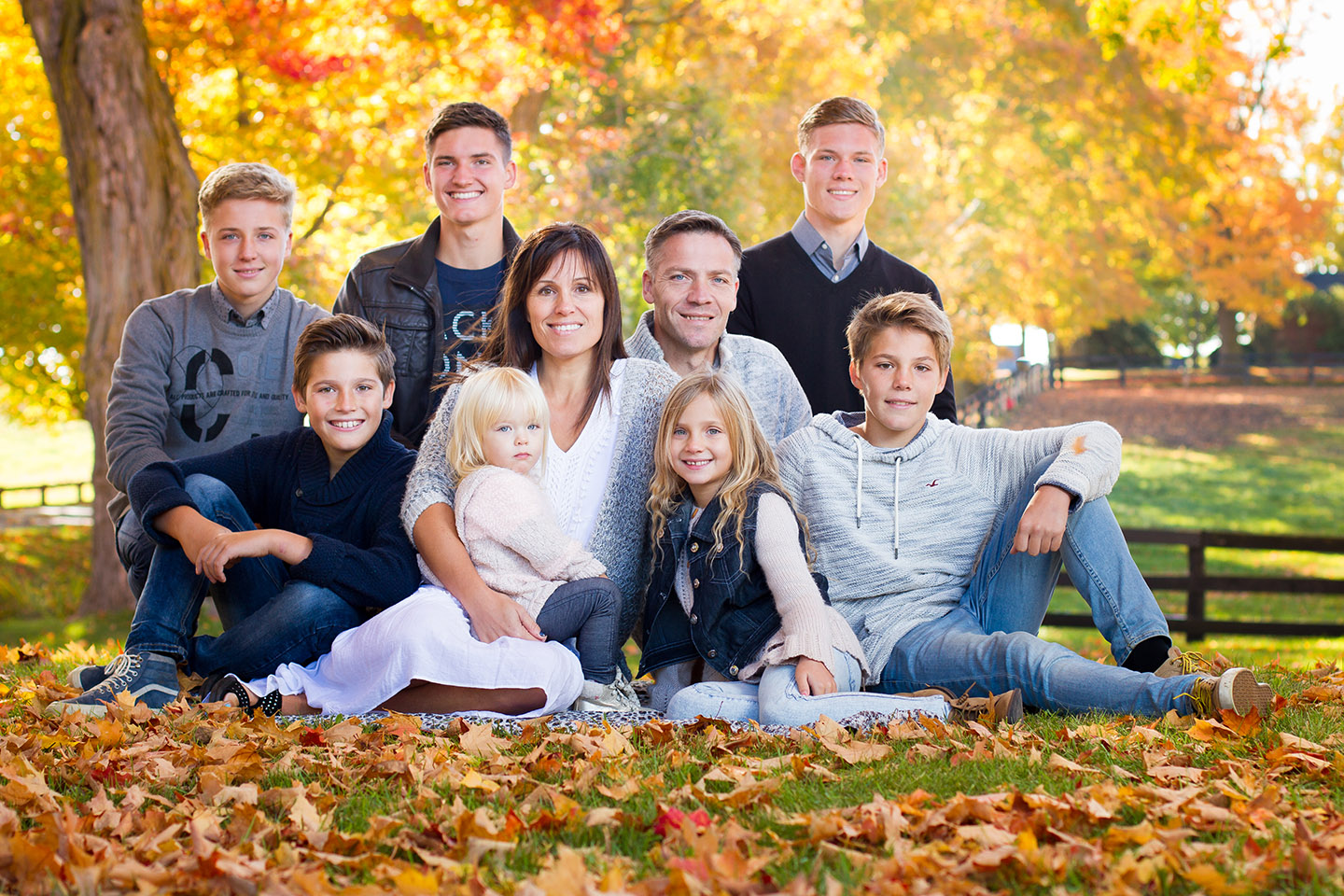 A portrait of a family taken during autumn in Orangeville by Frank Myrland Photography